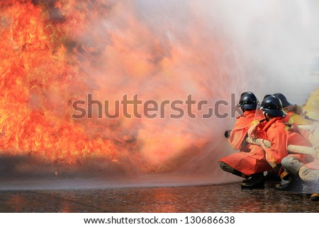 Firefighters fighting fire during training