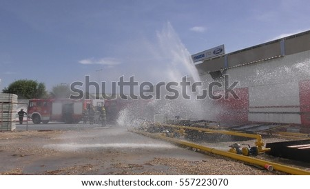 Firefighters from Zvulun spray water in burning factory, Akko â?? Israel, DEC 17th, 2016