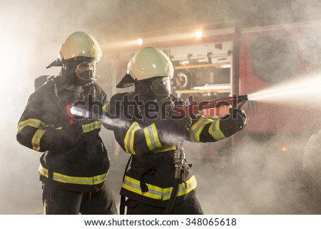 Firefighters in action battling the flames