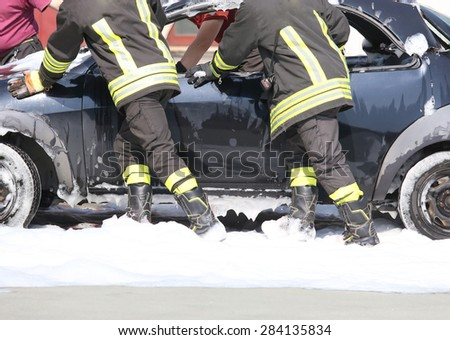 firefighters in action during a traffic accident