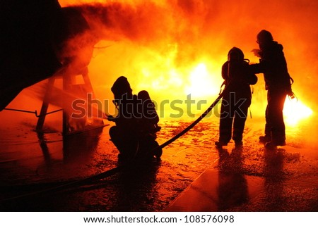 Firefighters in action in Sweden. - stock photo