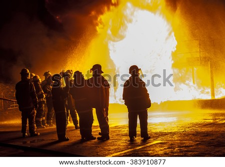 Firefighters observing structural fire