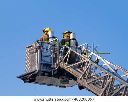 Firefighters on platform isolated on blue sky