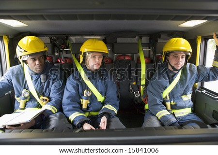 Firefighters on their way to an emergency scene - stock photo