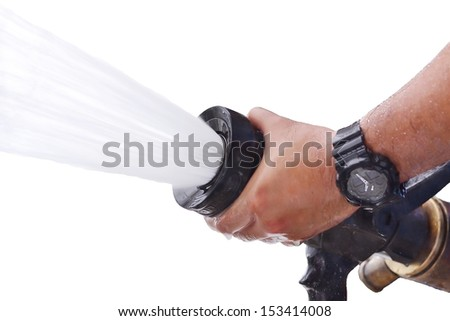 Firefighters spray water during isolate - stock photo