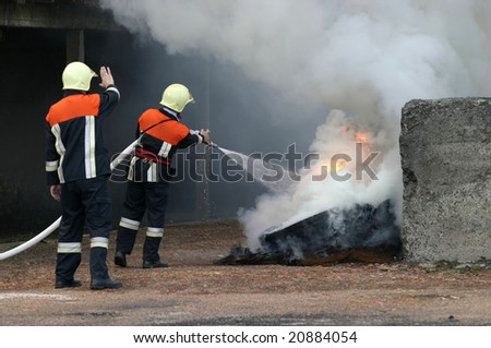 firefighters  spraying water - stock photo