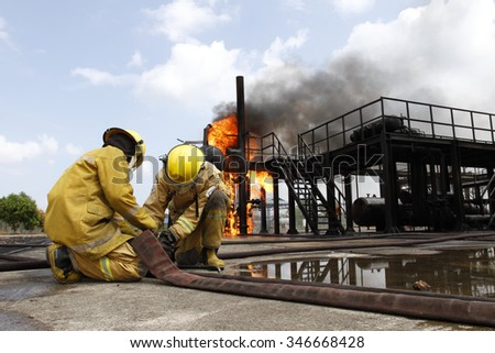 Firefighters training at fire training ground - stock photo
