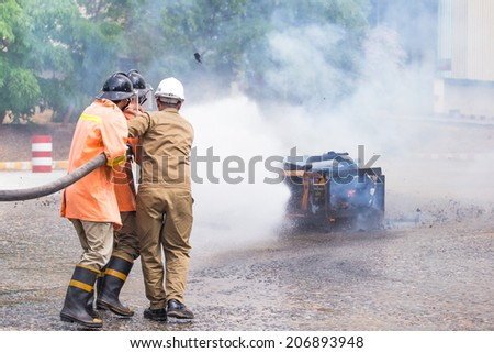 Firefighters training exercise - stock photo