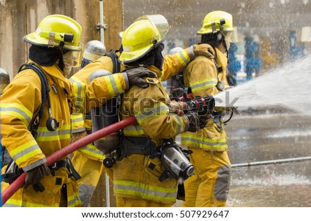 Firefighters training, foreground is drop of water springer, Selective focus.