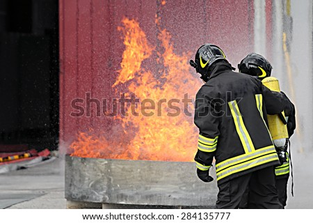 firefighters with oxygen bottles off the fire during a training exercise in Fire hall