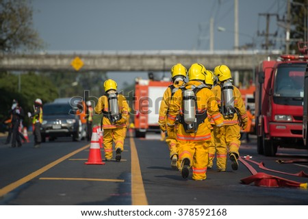 firefighters with oxygen suit while training - stock photo