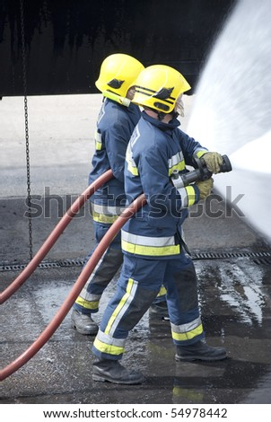 Firefighters working as a team