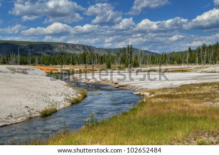 Firehole River in Black Sand Basin, Yellowstone. The small river is named Firehole River, which refers to not only the abundant hot spring along the river, but the big forest fire burned this area - stock photo