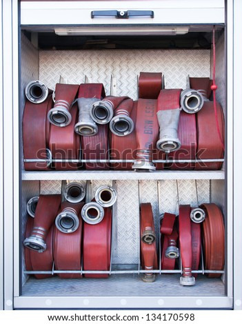Firehoses in a truck to be used by firefighters - stock photo