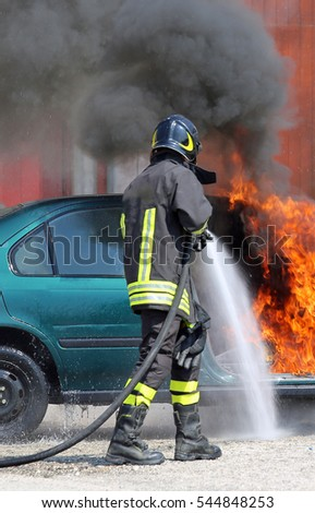 fireman extinguishes the fire of a car with foam after car accident