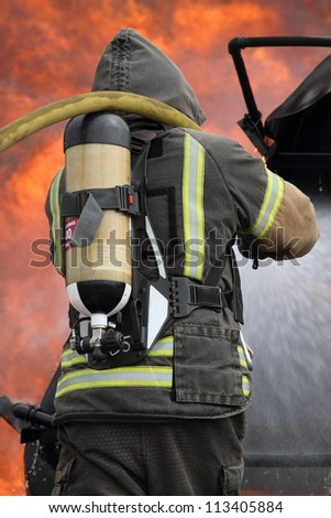 Fireman putting out a fire - stock photo