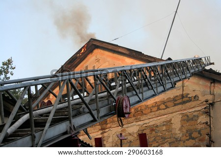 fireman wearing a gas mask on the stairs - stock photo