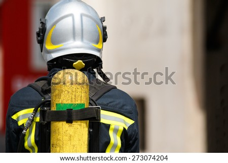 Fireman with oxygen tank - stock photo