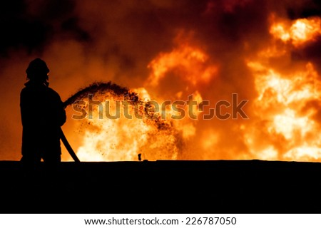 Fireman working in the night at the explosion