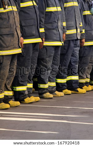 firemen pants and shoes after the fire, north china - stock photo
