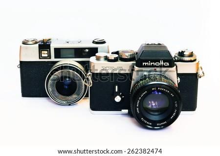 Firenze, IT - March 20, 2015: Vintage Minolta XE-5 reflex and Taron 50mm film camera - stock photo