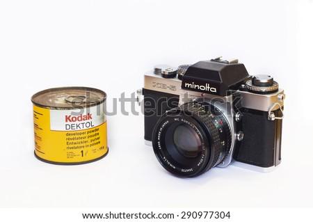 Firenze, IT - March 20, 2015: Vintage Minolta XE-5 reflex film camera and Kodak Dektol developer powder for print, 1971. - stock photo
