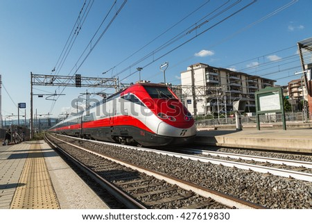 FIRENZE- ITALY: MAY, 5 2016: Trenitalia ETR 500 Frecciarossa is passing from the Station of Firenze Rifredi.