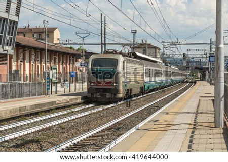FIRENZE- ITALY: MAY, 5 2016: Trenitalia Intercity Passenger Train is Departing from the station of Firenze Rifredi with E402B Electric Locomotive.