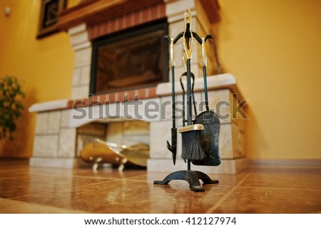 Fireplace accessories tools background fireplace - stock photo