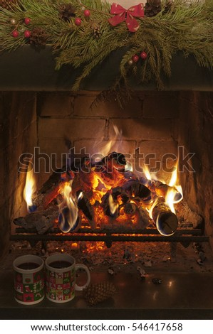 Fireplace and two  christmas cups