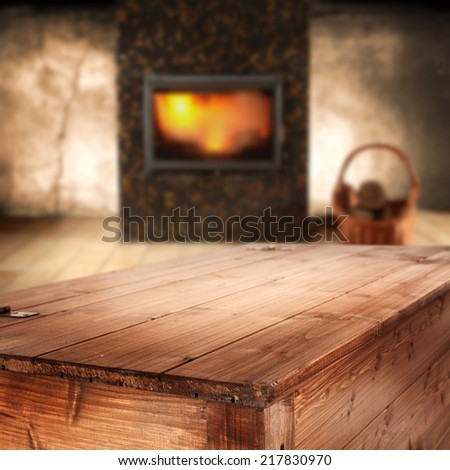 fireplace and wooden table  - stock photo
