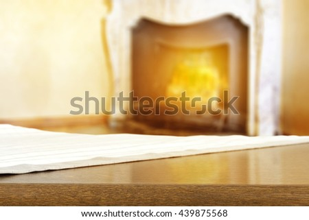 fireplace background and tablecloth and shelf and free place  - stock photo