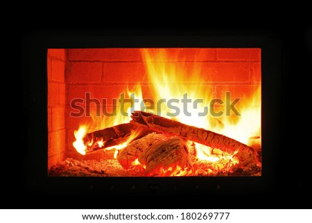 fireplace burning in the dark
