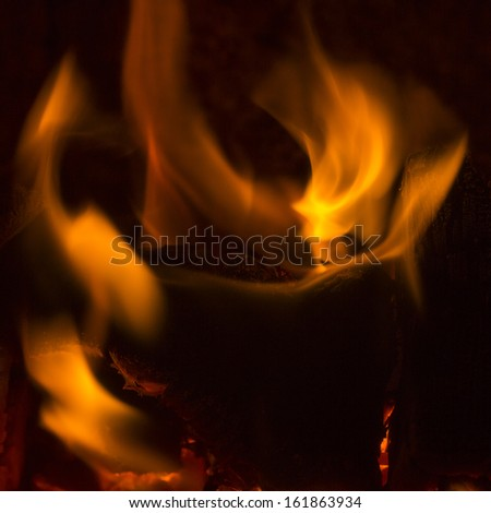 fireplace fire flame burn firewood cozy winter fossil energy on black - stock photo