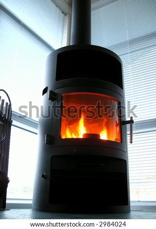 fireplace in a corner of a living room - stock photo