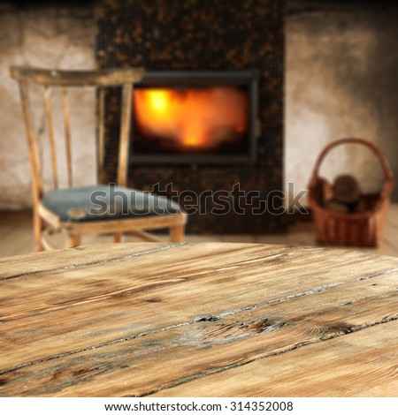 fireplace in room with wall and retro old chair of free space with table place