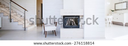 Fireplace in the open space inside the apartment, panorama - stock photo