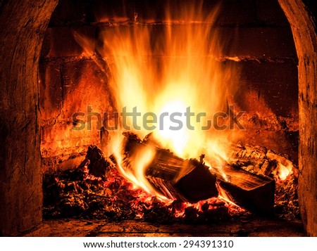 Fireplace with a blazing fire. Photo.