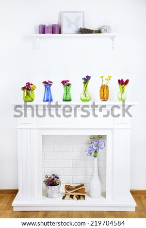 Fireplace with beautiful decorations in living room - stock photo