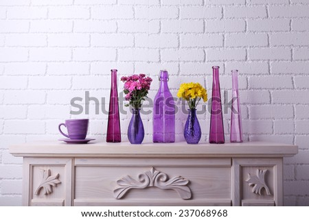 Fireplace with beautiful purple decorations in room  - stock photo