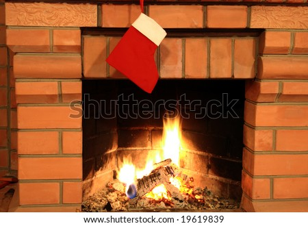 Fireplace with hanging red christmas sock