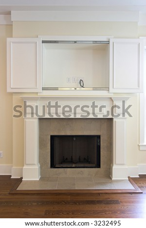 fireplace with open wall cabinet for flatscreen tv. Can be paired with 3232502 - stock photo