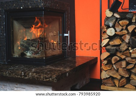 Fireplace with stack of firewoods