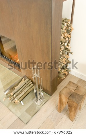 fireplace with tools and wood - stock photo