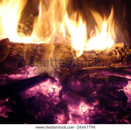 fireplace with wood and coal burning