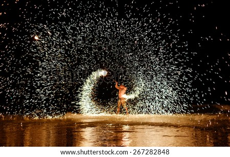 Firestarter performing amazing fire show at Koh Samed Samet island Thailand - stock photo