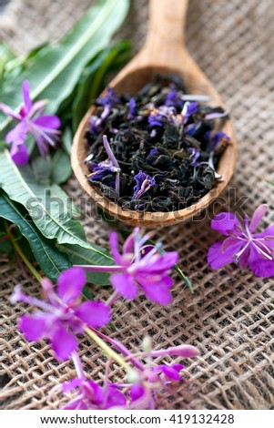 fireweed tea on wooden surface - stock photo
