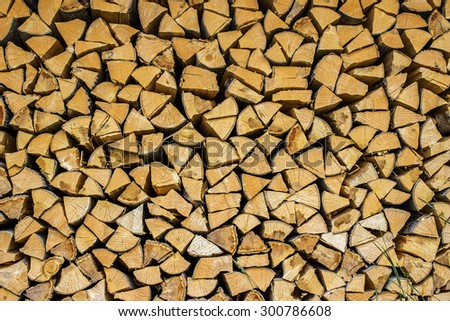 Firewood as a background. Pile of chopped firewood logs