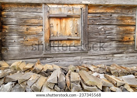 firewood at the wooden wall - stock photo