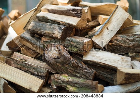firewood background - chopped firewood on a stack - stock photo